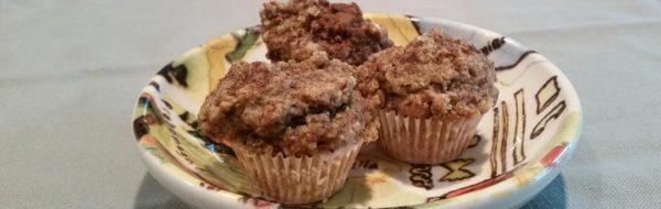 three banana quinoa mini muffins on small plate
